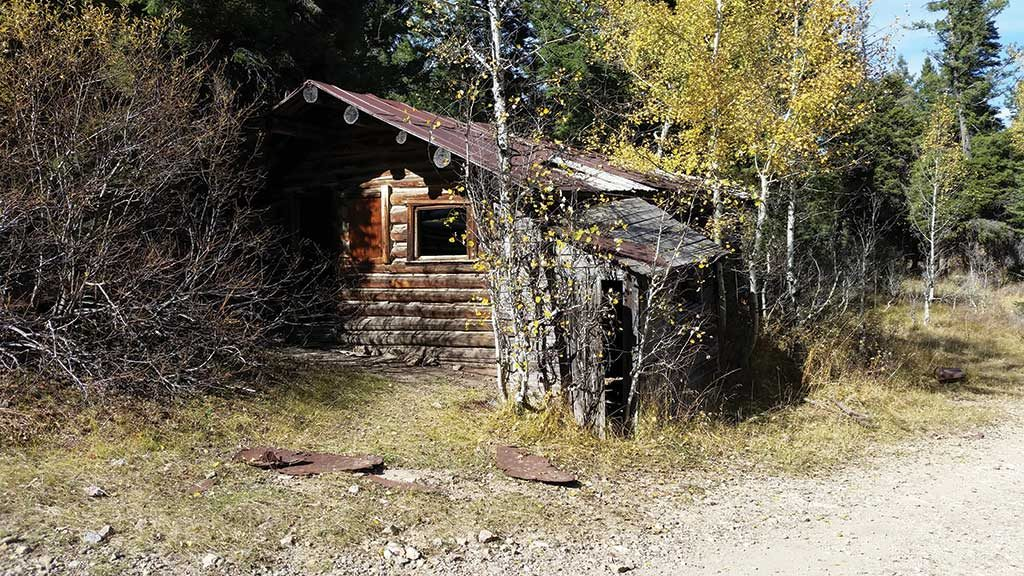 Cabins left on-site from mining activities at the Kilgore site in Idaho in the 1930s. Credit: Otis Gold.