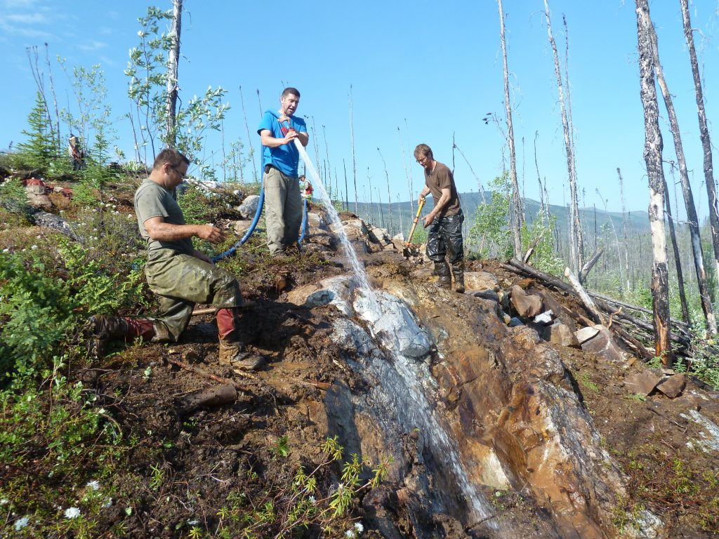 Washing down the discovery outcrop of the Goldstack zone at Goldstrike Resources' Plateau South property in the Yukon in 2013. Credit: Goldstrike Resources.