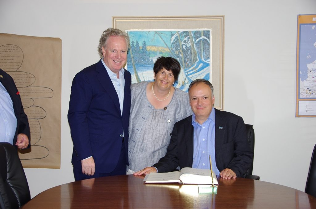 Signing the Plan Nord road agreement for the Renard diamond project in Quebec in August 2011, from left: Quebec Premier Jean Charest; unidentified; and Stornoway Diamond president and CEO Matt Manson. Credit: Stornoway Diamond.