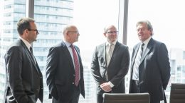 Roundtable participants mingle at the PwC office in Toronto. From left to right: Stephen Mullowney, a partner at PwC; Stephen Roman, Harte Gold CEO; John Cumming, TNM editor-in-chief; John Kearney, Canadian Zinc CEO.