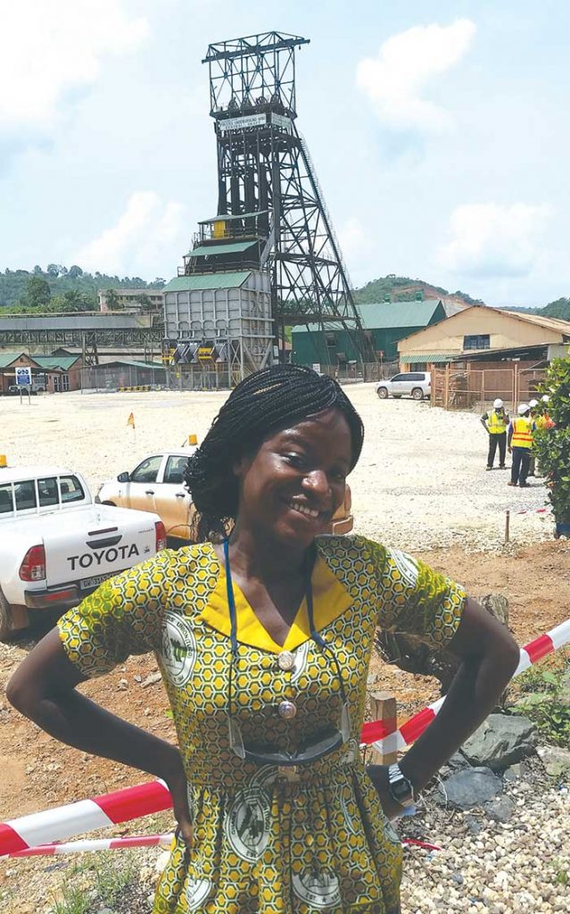 Mining shift boss Gifty Gandhi in front of the central shaft at Golden Star Resources' Prestea underground gold mine in Ghana. Photo by Trish Saywell.