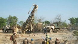 Workers oversee a drill rig at African Gold Group's Kobada project in Mali. Credit: African Gold Group.