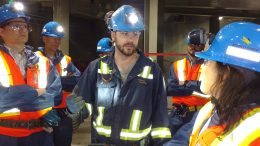 Frédéric Langevin (centre), mine manager at Agnico Eagle Mines' Goldex gold mine in Val-d'Or, Que., guides visitor on an underground tour in June 2017. Photo by John Cumming.