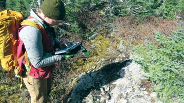 Field geologist Carly Smythe at work on Great Bear Resources' Dixie Lake gold property in Red Lake, Ontario. Credit: Great Bear Resources.