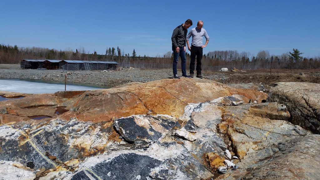 Probe Metals' VP of corporate development Patrick Langlois (left) and COO Yves Dessureault stand on outcrop at the Val-d'Or East gold project in Quebec. Credit: Probe Metals.