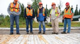 First Mining Finance president Patrick Donnelly (far left) looks over core samples with colleagues at the Springpole gold project, 110 km northeast of Red Lake, Ontario. Credit: First Mining Finance.