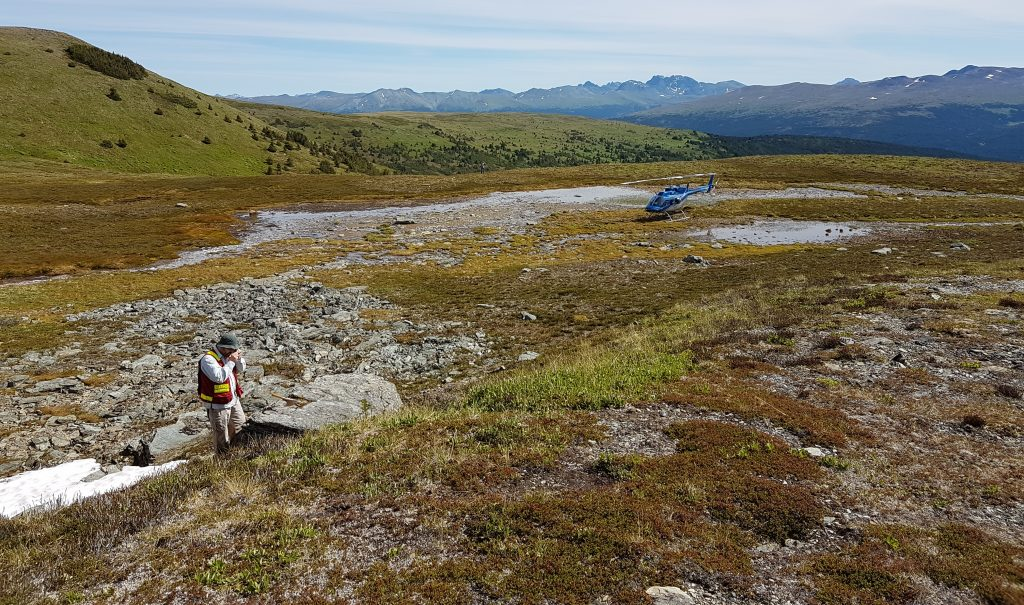 Examining rocks at Kutcho Copper Corp.'s Kutcho Copper property in British Columbia. Photo credit: Kutcho Copper Corp.