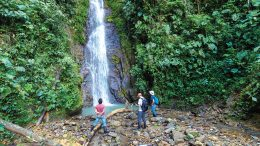 A stream sediment sampling crew planning its next move when confronted with a waterfall at Aurania Resources' Lost Cities-Cutucu gold property area. Credit: Aurania Resources.