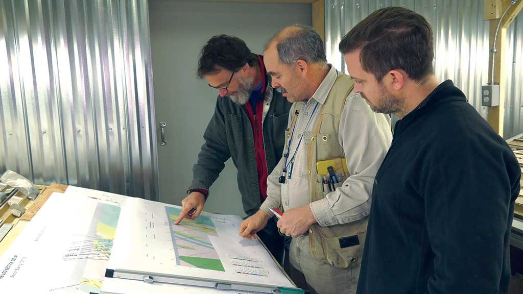 Examining maps at Maple Gold Mines' Douay gold project in Quebec, from left: David Broughton, director and head of the technical committee; Fred Speidel, vice-president of exploration; and Matthew Hornor, president and CEO. Credit: Maple Gold Mines.