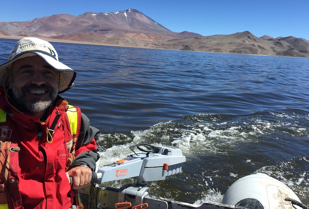 Waldo Perez, President and CEO of Neo Lithium Corp., boating on a lithium brine reservoir north of the 3Q project. Credit: Neo Lithium Corp.