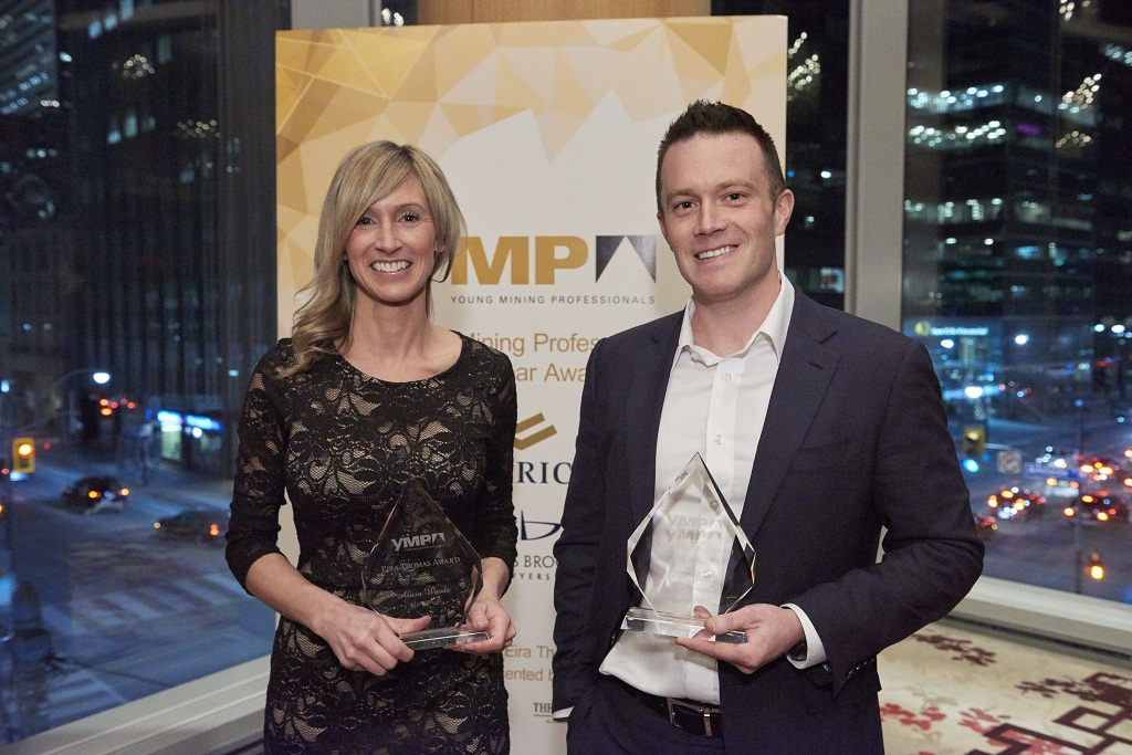 Alicia Woods, founder of Covergalls and general manager of Marcotte Mining Machinery Services, and Nolan Watson, president and CEO of Sandstorm Gold, with their YMP Awards at the Shangri-La Hotel in Toronto in March 2017. Credit: Young Mining Professionals.