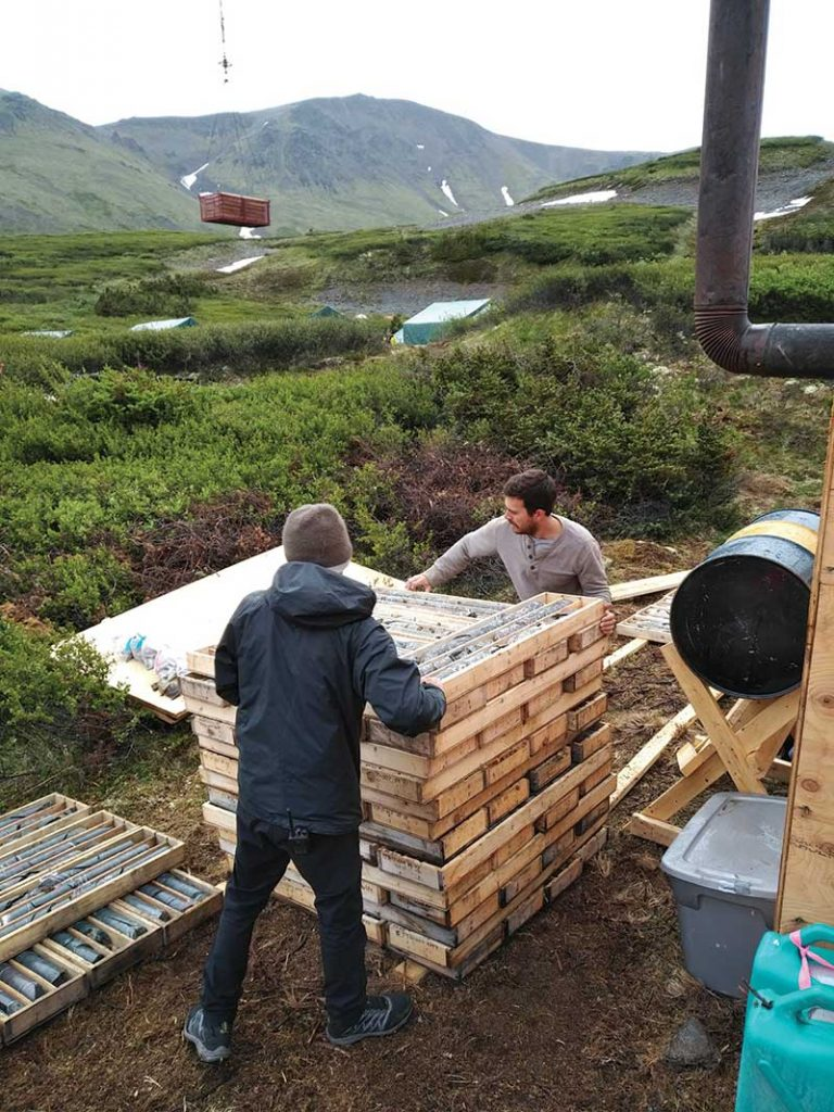 Workers handling core samples at GT Gold's Saddle gold-silver project in northern British Columbia. Credit: GT Gold.