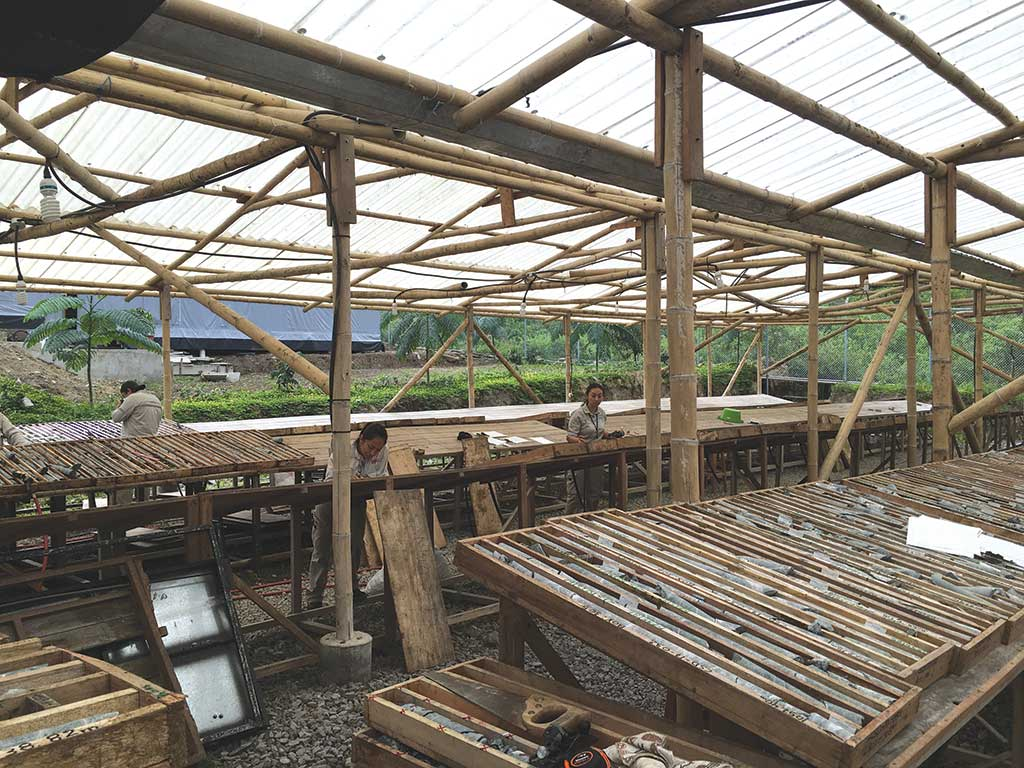 Workers in the core shack at SolGold's Cascabel gold property in Ecuador. Credit: SolGold.