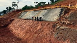 Workers stand near a batter under development to accommodate the primary crusher at Alphamin Resources' Bisie tin project in the eastern Democratic Republic of the Congo. Credit: Alphamin Resources.