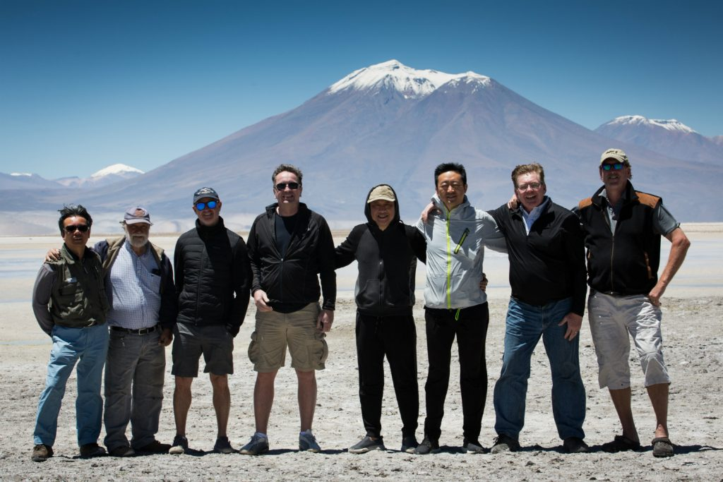 Lithium Chile CEO Steve Cochrane (second from right) poses with his team and guests on a visit to the company's property in Chile. Credit: Lithium Chile.