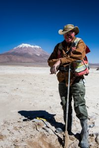 Lithium Chile senior geologist Eric Hansen on the company's Salar de Ollague property where it has auger sample as high as 1140 mg/l lithium. Credit: Lithium Chile.