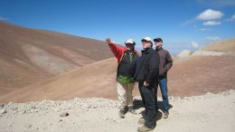 Atacama Pacific Gold chairman Albrecht Schneider (left) and analysts view the Cerro Maricunga oxide gold deposit, 140 km northeast of Copiapo, Chile. Photo by Atacama Pacific Gold.