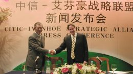 Ivanhoe founder Robert Friedland shakes hands with former CITIC chairman Wang Jun in 2003. Credit: Ivanhoe Mines.