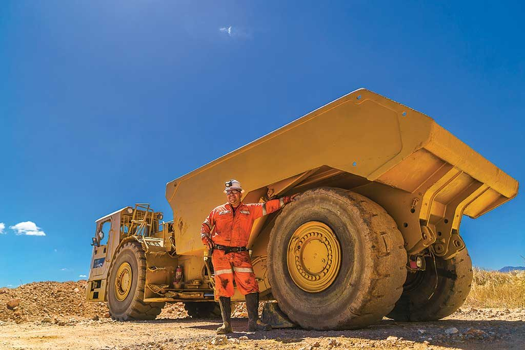 A worker and a haul truck at Bluestone Resources' Cerro Blanco gold project, in Guatemala. Credit: Bluestone Resources.