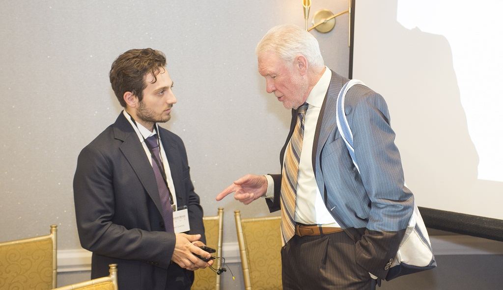 Grenville Thomas (right), chairman of North Arrow Minerals, speaks with Richard Quarisa, Northern Miner staff writer, at The Northern Miner's Diamonds in Canada Symposium in Toronto in June 2018. Photo by Erik Rotter.