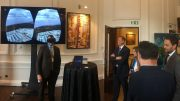 Matthew Keevil (left), vice-president of corporate affairs at Atac Resources, tries on VRify's 3D visualization technology at the Canadian Mining Symposium in London in April 2018, as Atac president and CEO Graham Downs looks on. Credit: VRify twitter.