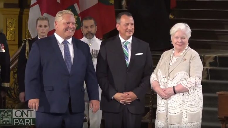 At the swearing-in ceremony for the new Ontario cabinet at Queen's Park in Toronto on June 29, from left: Premier Doug Ford; Minister of Energy, Northern Development and Mines, and Minister of Indigenous Affairs Greg Rickford; and Ontario Lieutenant General Elizabeth Dowdeswell. Credit: Premier of Ontario YouTube Channel.