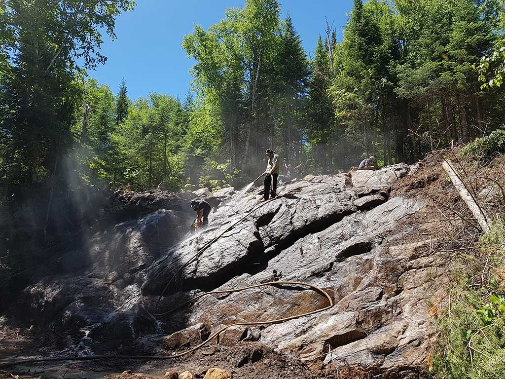 Cleaning one of the trenches at Kintavar Exploration's Mitchi copper project in Quebec. Credit: Kintavar Exploration.