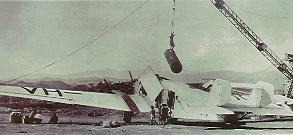 Unloading a Junkers aircraft at Placer Development Corp.'s Bulolo gold operation in New Guinea in the 1930s. Credit: Placer Dome.