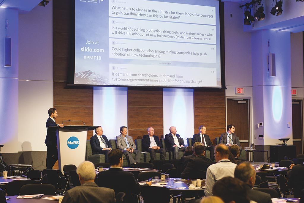 Participants in the clean mining panel field questions from the audience at the Progressive Mine Forum in Toronto, from left: The Northern Miner staff writer Richard Quarisa (moderator), Cory McPhee, Vale's VP of corporate affairs, communications and sustainability; Carl Weatherell, Canada Mining Innovation Council CEO; Nathan Stubina, McEwen Mining's managing director of innovation; Jason Goodhand, e-Zn Inc.'s VP of business development; Raziel Zisman, Whittle Consulting's co-founder and partner; and John Mullally, Goldcorp's VP of corporate affairs and energy regulation. Photo by George Matthew Photography.