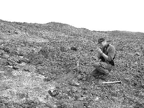 Anglo American geologist Dan MacNeil examines the Discovery gossan at the Frontier South property in far-northern Quebec.