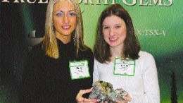 The hunt for precious stones in Canada also extends to emeralds and sapphires. Above, Holly Johnson, an office administrator with True North Gems, and geologist Bonnie Pemberton hold emerald and sapphire mineralization from the Yukon and Baffin Island, respectively.