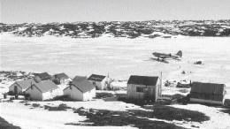 A plane carries supplies and personnel to Wolfden Resources' High Lake camp in Nunavut.