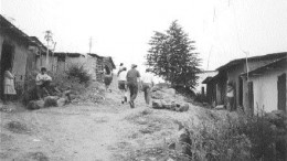 Mining personnel from Manhattan Minerals walk through the village of Tambogrande in northwestern Peru in 1999. Local opposition to Manhattan and its Tambo Grande project eventually scuttled the company's plans to develop rich polymetallic deposits under and near the town.