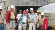 Greystar Resources vice-president Frederick Felder (red hardhat) and president David Rovig (on Felder's left) pose with employees at a portal leading into the Angostura gold deposit.