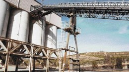 JOHN CUMMINGThe Aguas Teidas mine site includes well-maintained offices and maintenance sheds, an operating mine-water treatment plant, a 300-tonne-per-hour primary crusher and these four 400-tonne ore-storage bins.