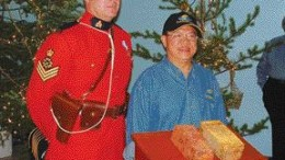 SAN GOLDSergeant Douglas Ashton of the Powerview, Man., RCMP detachment and James Wong, chief underground geologist with San Gold, pose with two gold bars poured from the company's new Rice Lake mine, near Bissett in northern Manitoba.
