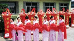 MICHELAGOA traditional Chinese ceremony in July 2005 marks the transfer of the bacterial oxidation plant in the gold-mining town of Laizhou, Shandong province, to Aussie miner, Michelago. The pillars in the background represent wisdom. And the women are holding trays of flowers, each with a pair of scissors to cut the opening ribbon. The BacOx plant, the largest of its kind in China, processes third-party concentrates at a rate of about 150,000 oz. gold annually and is key to an impending merger between Toronto-based Golden China Resources and Michelago.