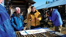 VIVIAN DANIELSONWestern Keltic Mines' vice-president of exploration, Peter Holbek (centre, yellow), explains the geology of the Kutcho Creek massive sulphide project during a site visit to Dease Lake, northern B.C.
