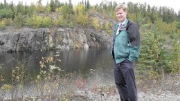 THE NORTHERN MINERRobin Dunbar, president of Mustang Minerals, stands near the flooded Maskwa open pit, northeast of Winnipeg in 2004.
