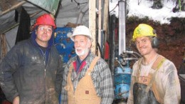 Taking a break from drilling on the East Emerald zone at Sultan Minerals' Jersey Emerald property in southeastern British Columbia. From left: Richard Lawrick of Prospector Diamond Drilling, Sultan project manager Ed Lawrence, and driller's helper David Little.