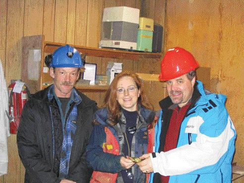 One of the first gold bars to be poured at Cusac Gold Mines' Table Mountain mine in northern British Columbia. From left: Mine manager Kevin Fitzpatrick; vice-president, exploration Lesley Hunt; and Cusac CEO David Brett.