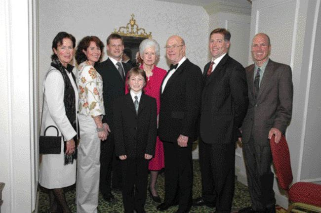 KEITH HOUGHTON PHOTOGRAPHYNewsletter writer and inductee George Cross (centre, in tuxedo) with his family.