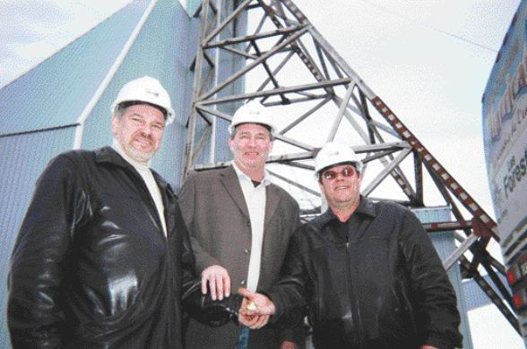 BY SUSAN KIRWINAnyone lose a button? From left: Yves Gagnon, Serge Roy and Ghislain Morin hold the last 6 oz. of gold poured at the Bachelor Lake mill in 1989. The mill is currently undergoing a $3-million facelift and will be ready to take ore from the Barry Lake open-pit deposit by mid-August.