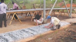Midlands Minerals president and CEO, Kim Harris, examines core samples at one of the company's properties in Ghana.