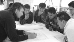 A team of Aurelian Resources geologists brainstorm at the huge Fruta Del Norte gold-silver project, in Ecuador. Exploration in the country was frozen in April and most concessions revoked, but a Mines Ministry official says the government is nearly finished work on a new mining law and juniors could be back in business by mid-October.