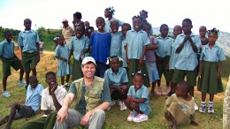 Eurasian president and CEO David Cole, surrounded by children at the Treuil camp in northwestern Haiti.