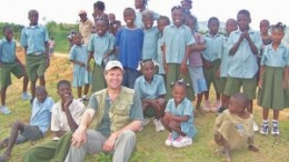 Eurasian Minerals president and CEO David Cole, surrounded by children at the company's Treuil camp, in northwestern Haiti.