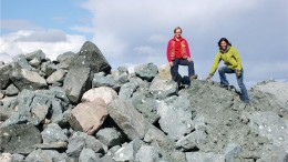 Shear Minerals president and CEO Pamela strand and executive chairman Julie Lassonde stand on a stockpile of unprocessed kimberlite at Jericho, in Nunavut. Credit: Shear Minerals.