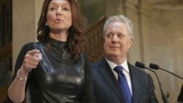 Nathalie Normandeau and Quebec Premier Jean Charest at her resignation press conference.