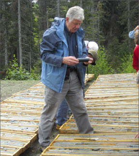 First Point Minerals president Peter Bradshaw looks at awaruite core at the Decar project in central British Columbia. Photo by Matthew Allan